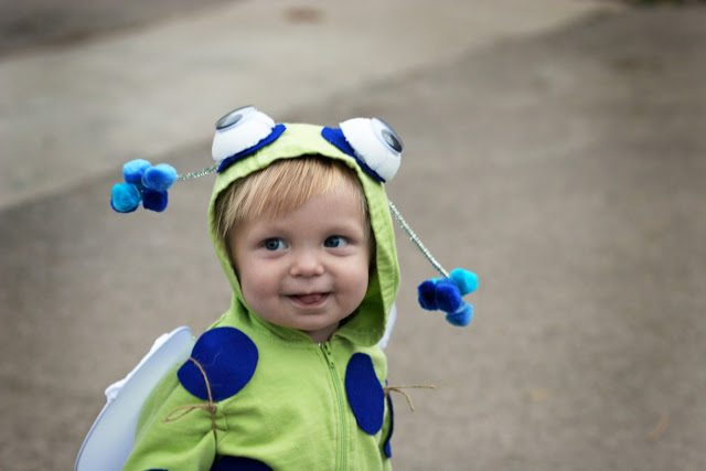 Little boy playing in a baby bug costume