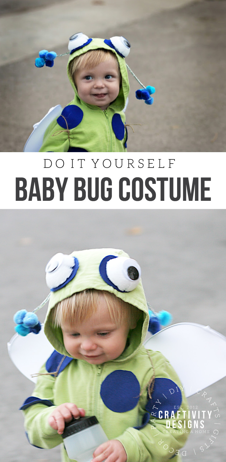 Little boy smiling and wearing a baby bug costume