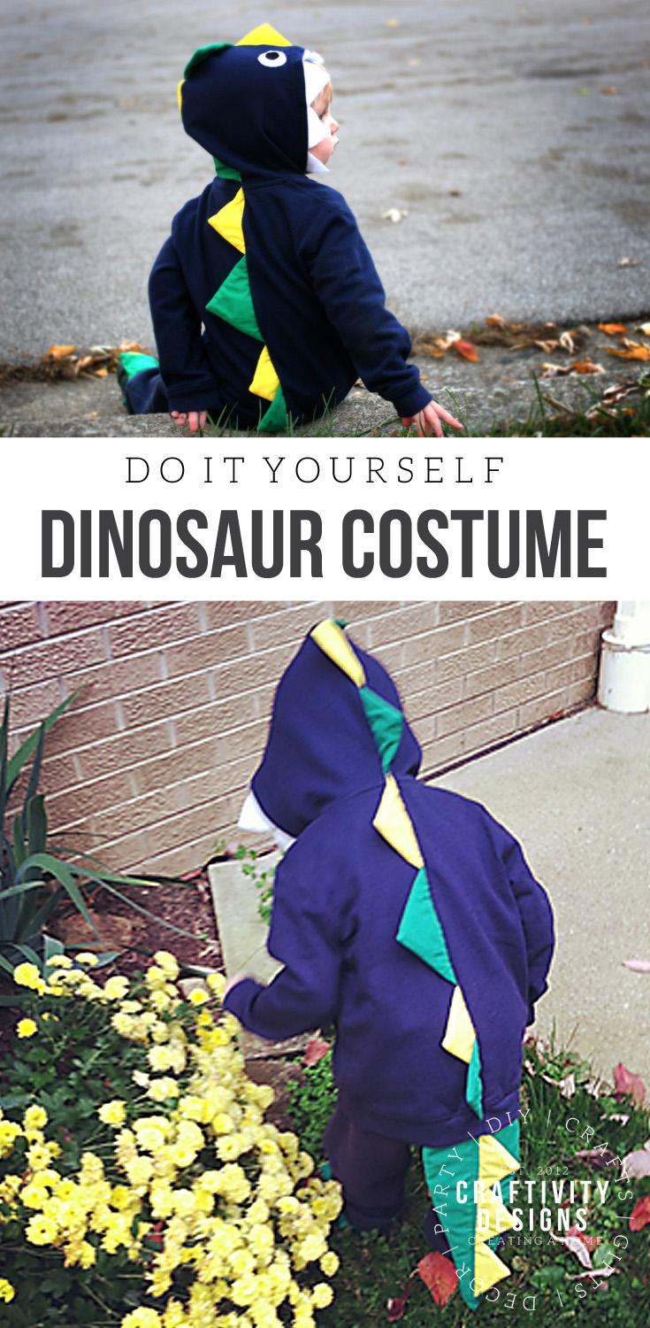 Little boy playing in a DIY dinosaur costume