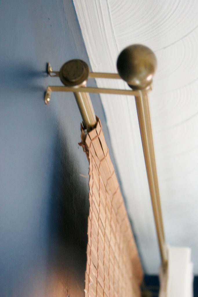 diy bamboo blinds hanging on a curtain rod
