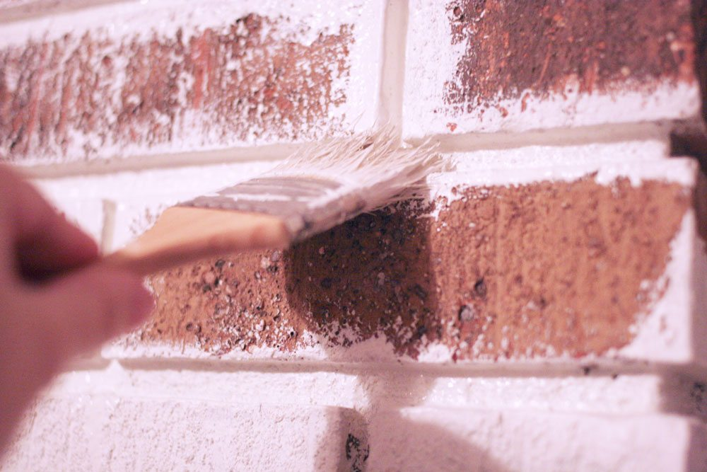 painting brick mortar lines with a brush