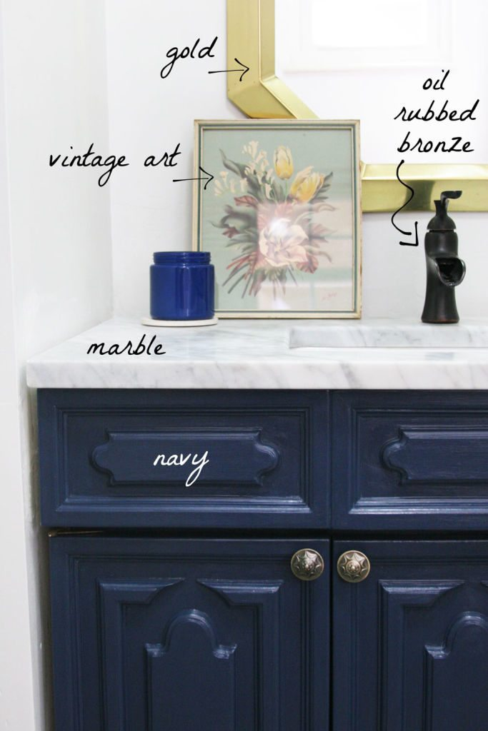 Plan for Bathroom includes navy cabinetry, marble counters, gold and oil-rubbed bronze finishes and grey ceramic floor tile. by @Craftivity