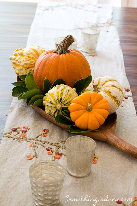 magnolia leaves with citrus leaves and pumpkins gourds as a centerpiece