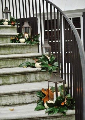 magnolia leaves on steps with lanterns