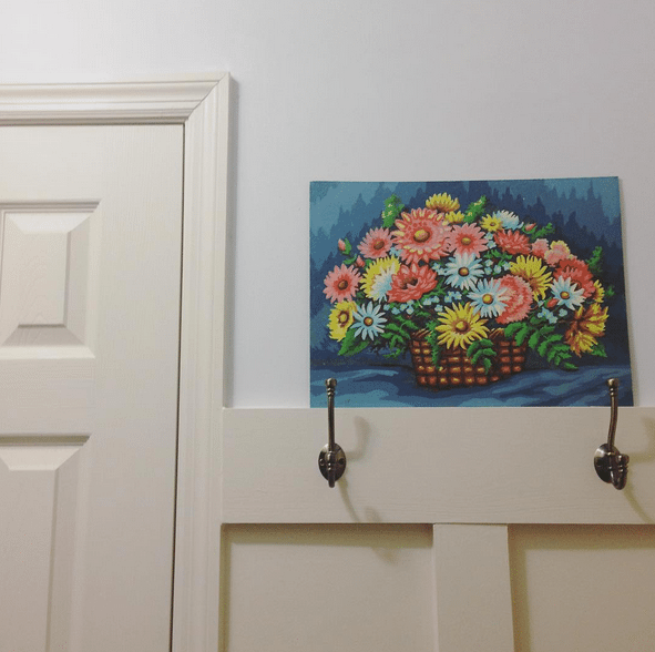 Floral Paint by Number in teh Laundry Room. Board and Batten paired with large hooks and light gray paint. by @craftivityd