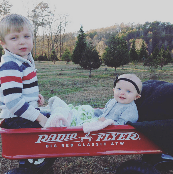 Visiting the Christmas tree farm and pulling the kids in a red wagon.