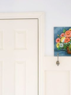 double wall hooks in a mudroom laundry room combo