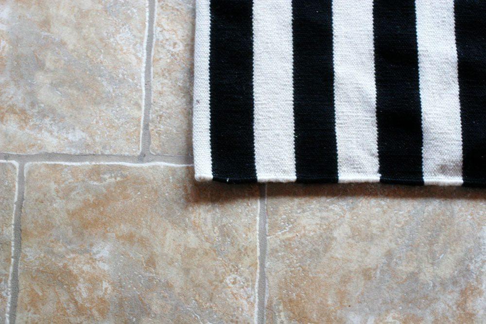 choosing a rug pad for tile floors by craftivityd sunroom family