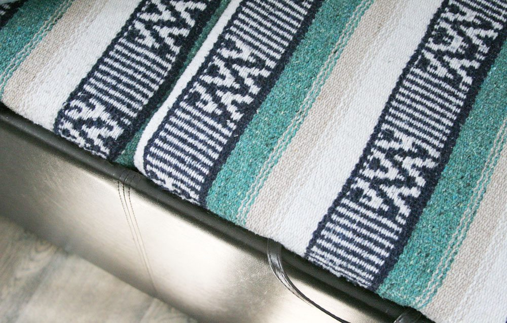 Storage Ottoman Makeover -- Reupholster an Ottoman -- Update a plain Ottoman or Bench with a Festival Blanket -- Mexican Blanket Projects -- DIY, Light & Bright Eclectic Home Tour by @CraftivityD