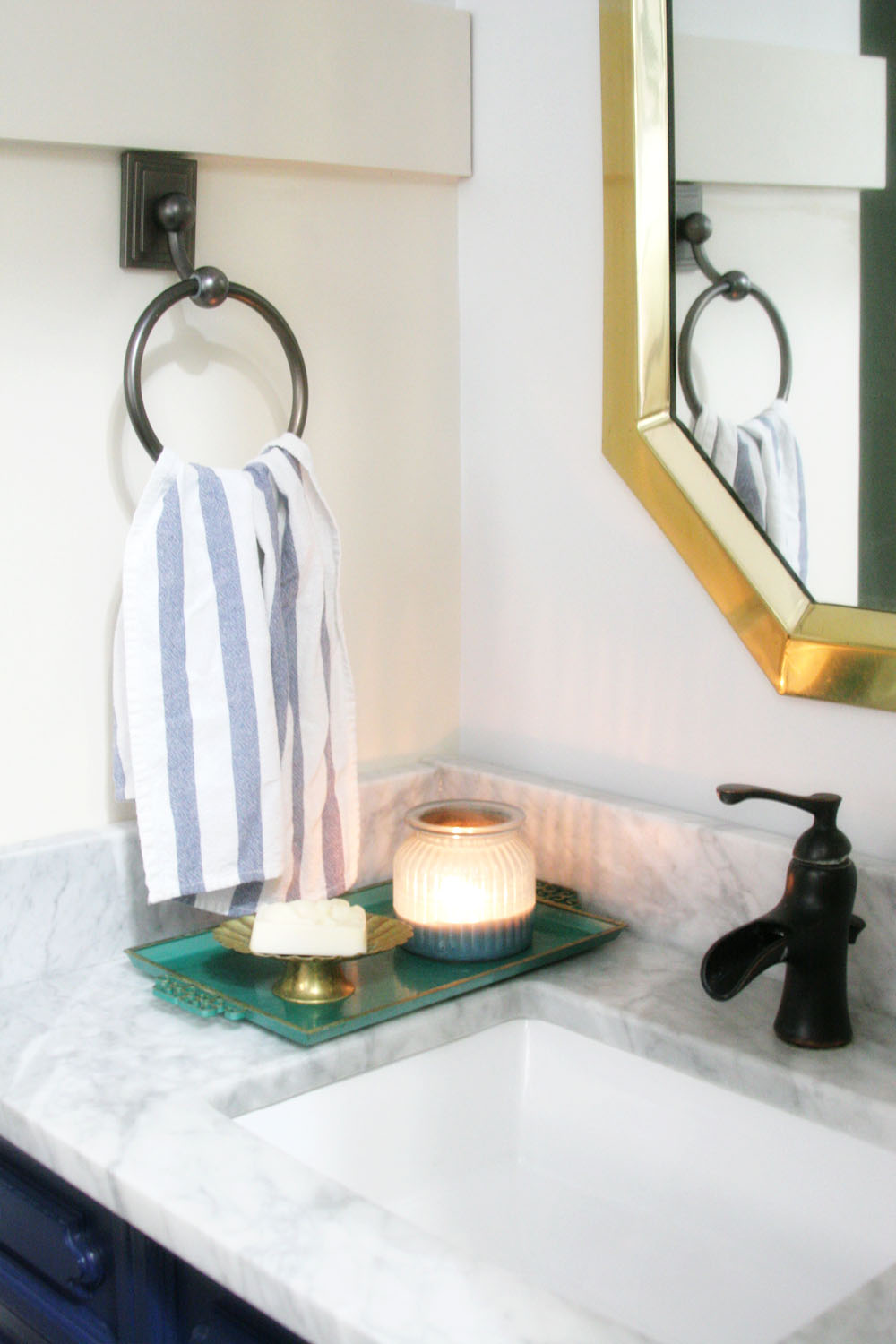 Navy and white bathroom renovation with vintage art for Small bathroom navy