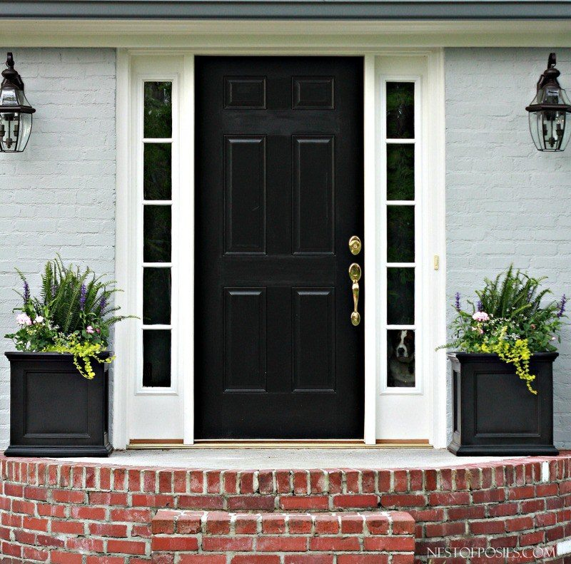 Painted brick exterior with a bold black door for a front door idea