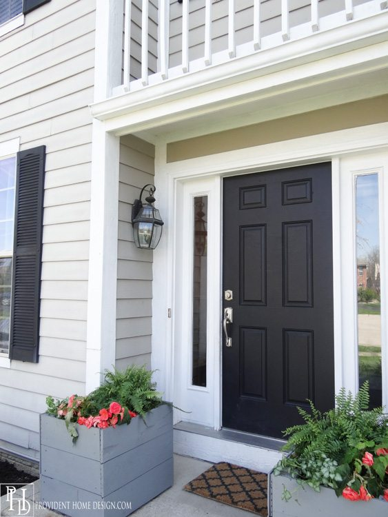 Black front door ideas contrasting a light home exterior