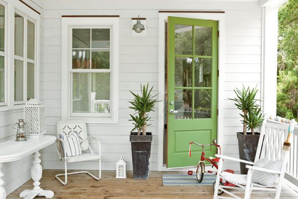 White exterior home with a chartreuse door idea