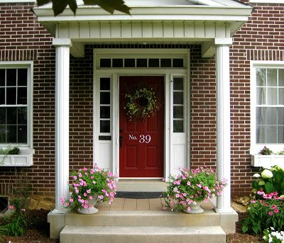 A home with brick exterior and a red door idea
