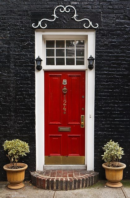 Black painted brick home and a red door idea