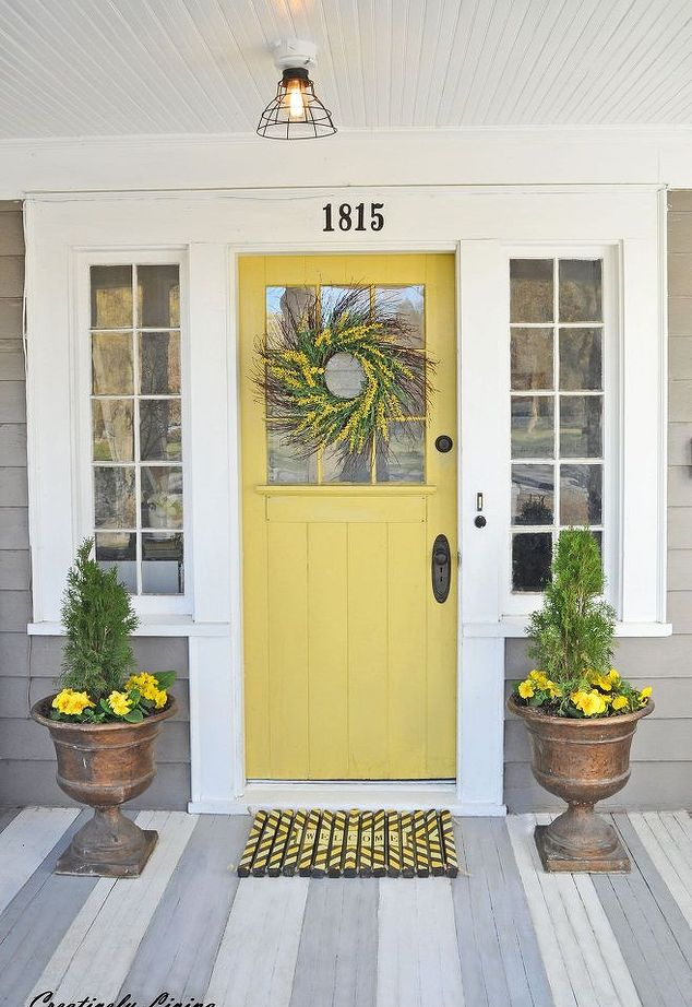 Grey siding with a yellow front door idea