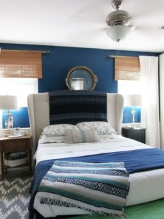 Navy Master Bedroom: navy walls, upholstered headboard, custom wardrobes, white bedding, upholstered ottoman, white curtains, bamboo blinds by @CraftivityD