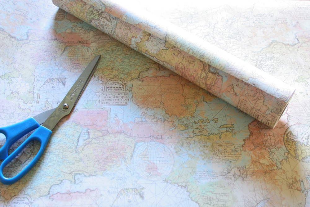 roll of decorative map paper with scissors