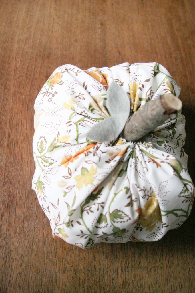 How to Make a Fabric Pumpkin from a Cloth Napkin. Fabric Pumpkins, Ticking Pumpkin, Floral Pumpkin, Fall Craft by @CraftivityD