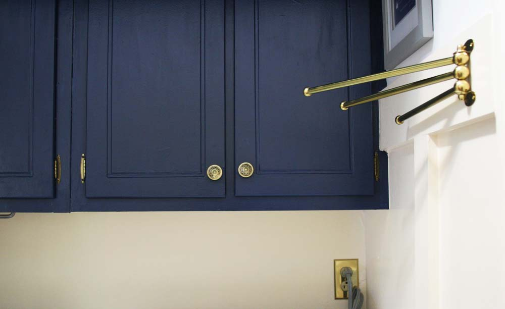navy laundry room cabinets