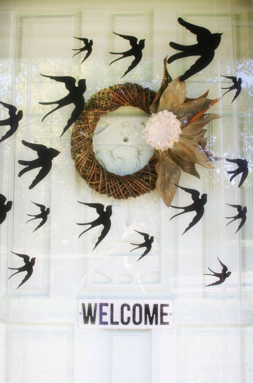 Fall wreath and flying bird adhesives used as DIY outdoor Halloween decorations