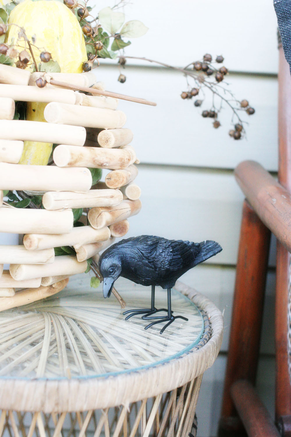 A decorative crow figurine used as a DIY outdoor halloween decoration