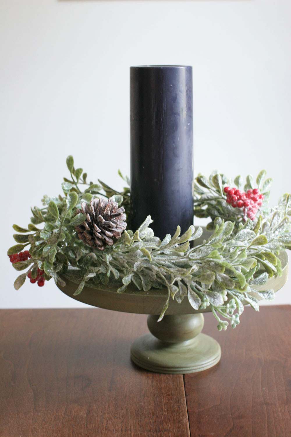 a diy modern advent wreath with a black candle