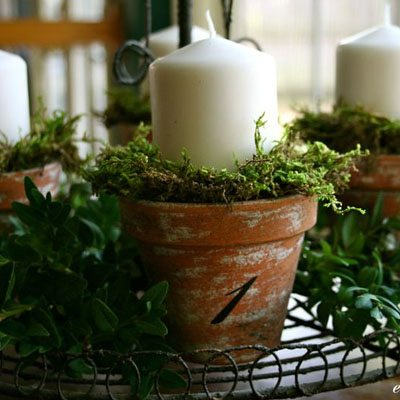 DIY Advent wreath with candles in a clay pot