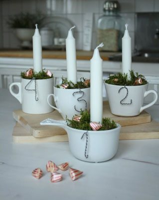 DIY Advent Wreath using white mugs and wire numbers