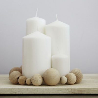 DIY Advent Wreath made with candles and wooden beads.