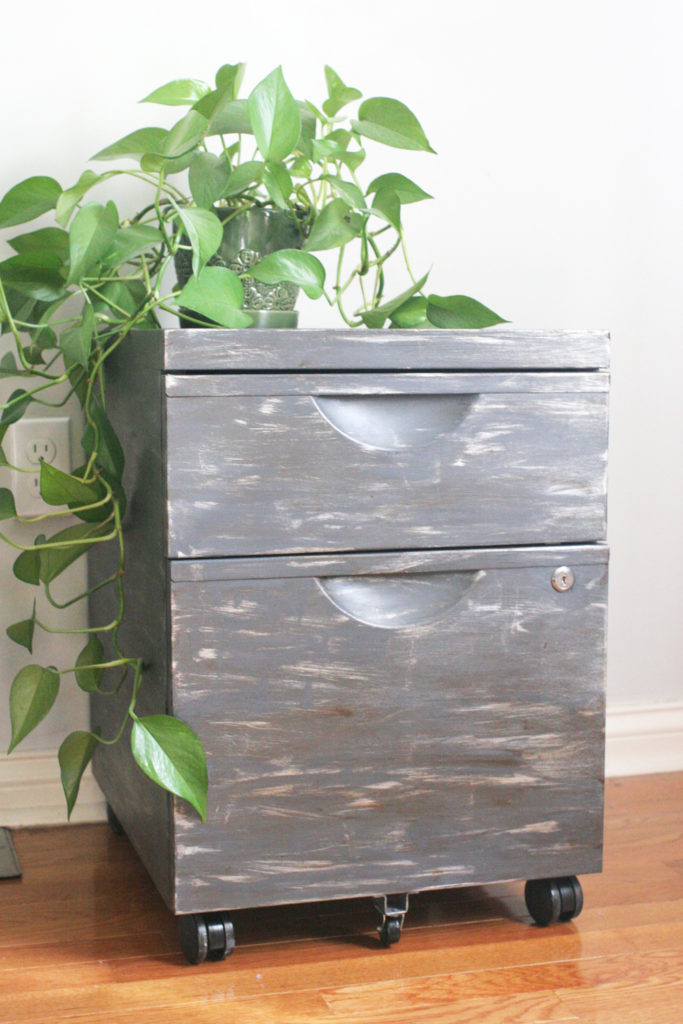 How to apply a faux zinc finish to a basic file cabinet for an rustic industrial makeover. Thrift store upcycle. Click the image to view the full tutorial with photos and paint colors.