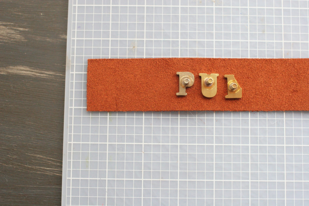 Learn how to make DIY Leather Drawer Pulls with labels on the pull for a child's bedroom. Click through for the full tutorial.
