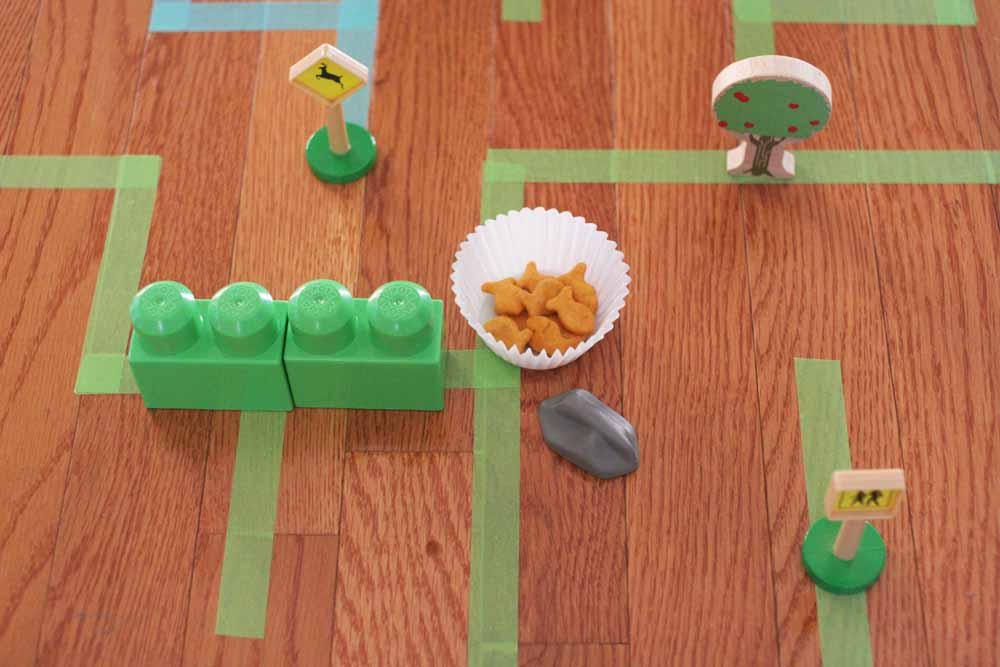 How to make a Giant Floor Maze. This is a great indoor activity for kids that gets them moving and thinking analytically. Click through to get the Giant Floor Maze Template. by @CraftivityD