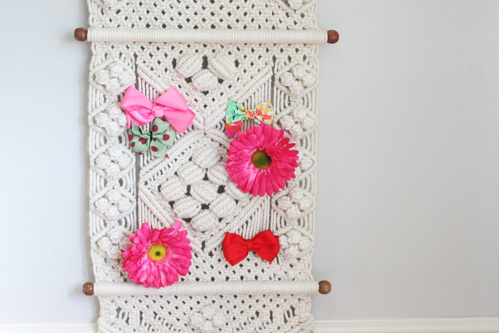 Macrame wall hanging to hold hair bows for nursery on a budget