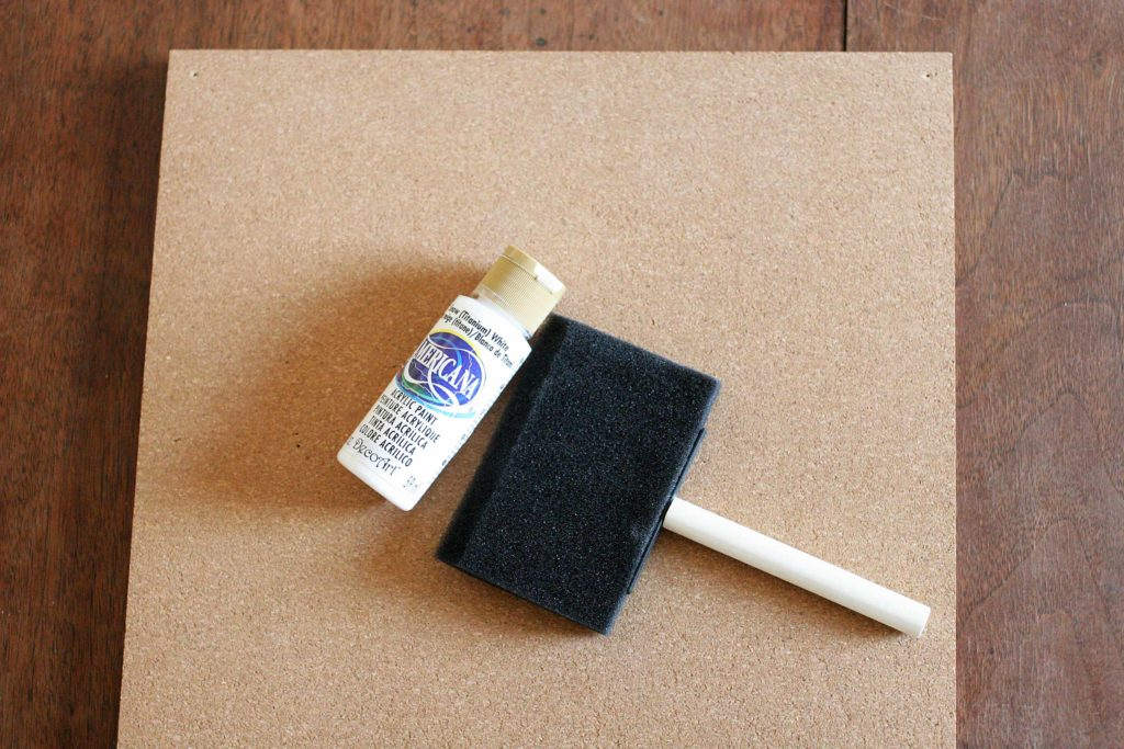 Foam paint brush, white craft paint and cork tiles for a Disney Countdown Calendar