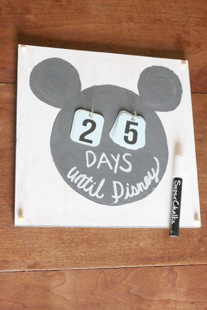 "A Disney Countdown Calendar that says ""Days until Disney"" written in Chalk Marker"
