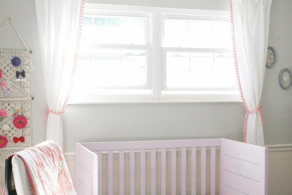 Take a tour of this modern bohemian nursery for a baby girl. Featuring vintage decor, modern boho design, and a pink crib, it's the sweetest bohemian bedroom!  #modern #bohemian #nursery Modern Boho Nursery | Modern Boho Style | Pink Crib | Modern Bohemian Nursery