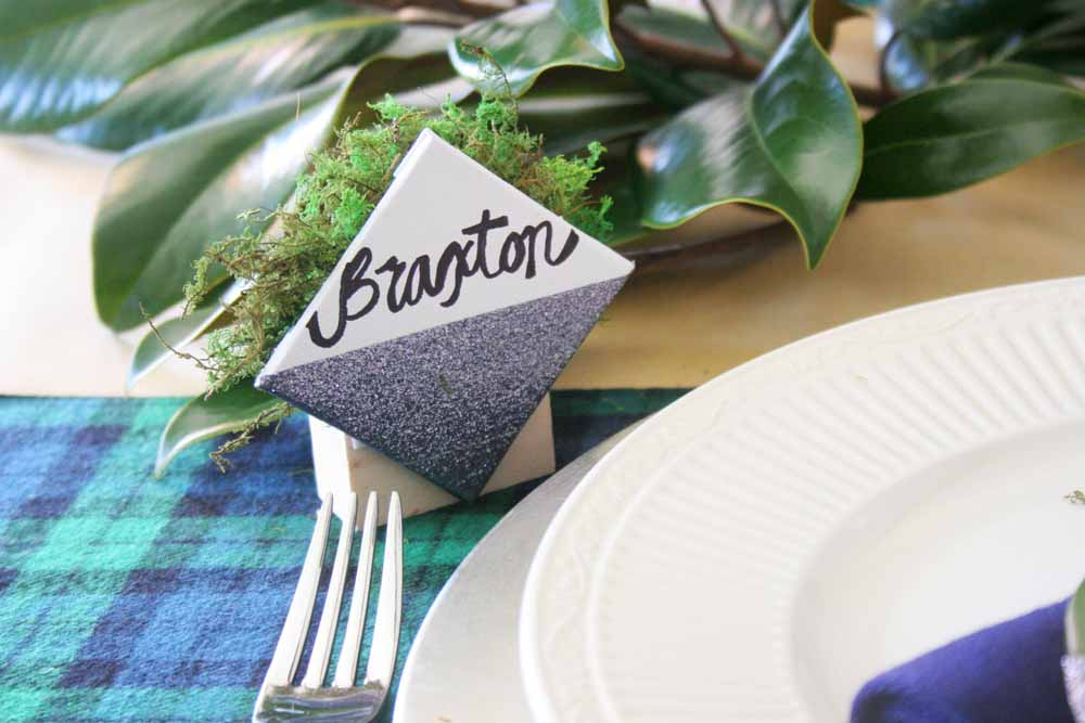 You'll love theseeasy Christmas table ideas that can be made in minutes, including DIY napkin rings, name card holders, and drink markers. #tablescape #party #christmas