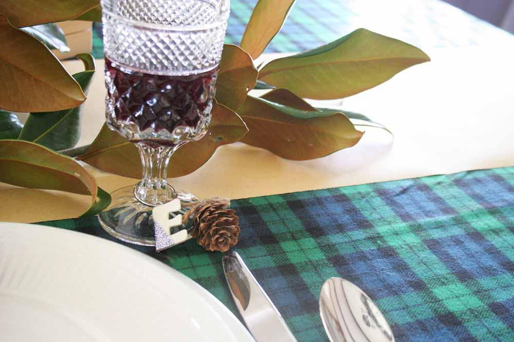 You'll love these easy Christmas table ideas that can be made in minutes, including DIY napkin rings, name card holders, and drink markers. #tablescape #party #christmas