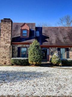 brick cottage style home, dormers, brick chimney