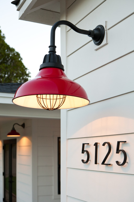 red gooseneck light, modern house numbers, white siding