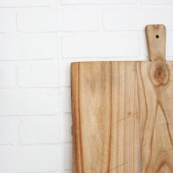 faux brick backsplash, wood bread board