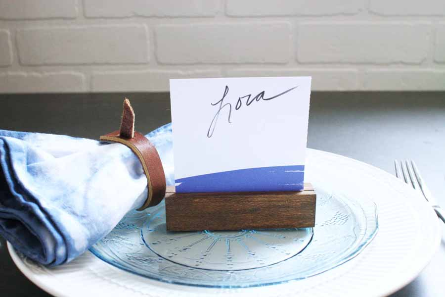 Wood Place Card Holder with Navy Place Card, Shibori Fabric Napkin with Leather Napkin Ring, Blue and White Plates