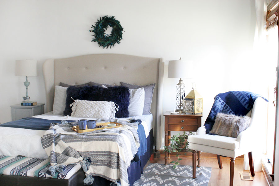 Eclectic Christmas Bedroom with Navy Bedroom Decor, White Walls, and Wood Trim