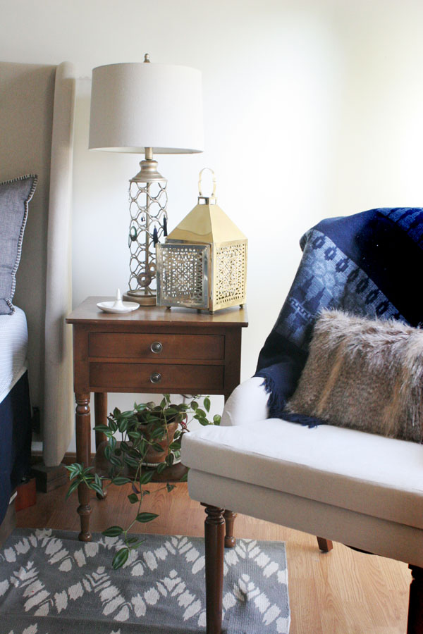 Eclectic Bedroom with Vintage Night Stand and Upholstered Wingback Chair