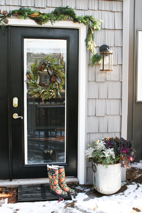 Black Door with Christmas Wreaths and Garland and Gray Cedar Shake Vinyl Siding