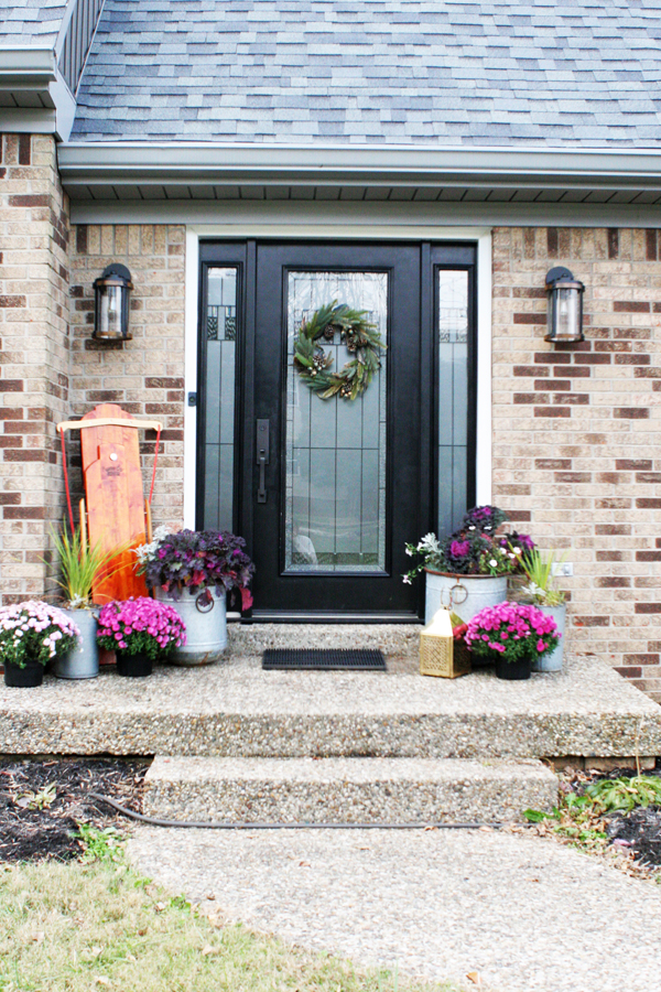 Brick Home with Black Front Door and Christmas Front Porch Decor