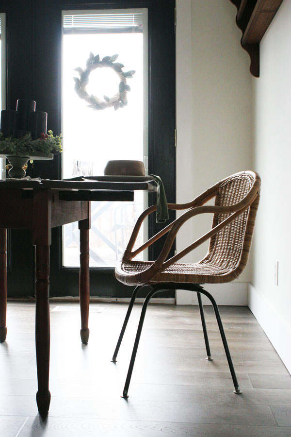 eat in kitchen or breakfast nook with black french doors, antique table, wicker chairs
