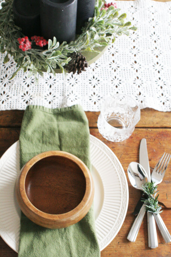 rustic christmas table setting with lace runner and christmas centerpiece