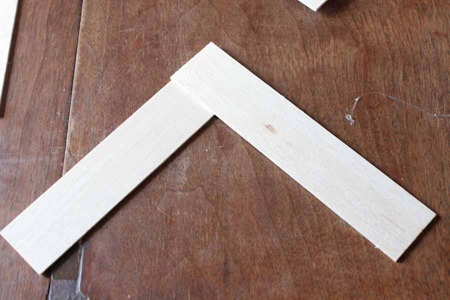 glue two pieces of balsa wood together